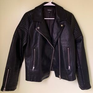 This is a Topshop faux leather jacket.